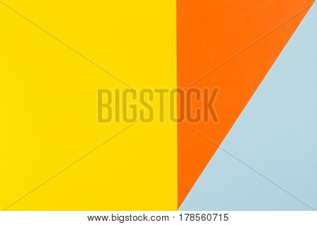 Paper color yellow, orange and blue background