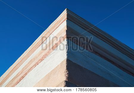 stone wall with the blue sky - perfect background or texture for your concept or project