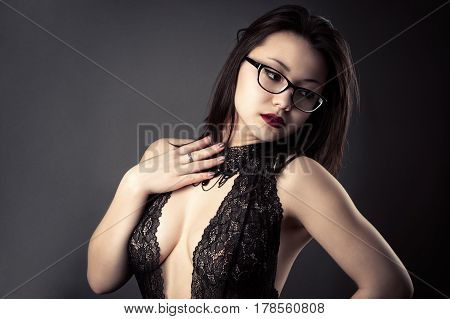 sexy attractive girl in lace bodysuit closeup