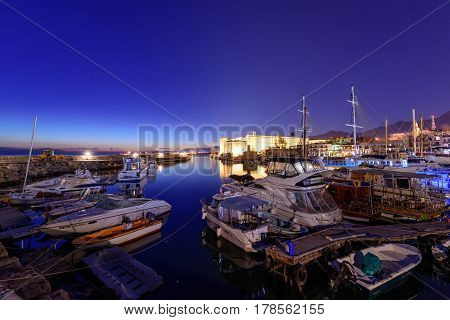 KYRENIA, CYPRUS - MARCH 26, 2017: Beautiful night view of Kyrenia harbour and ancient fortress. Kyrenia (Girne) harbour is one of the most popular tourist attractions in Cyprus.