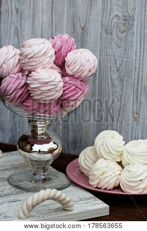 Color zephyrs in glass jar. Wedding cande bar. pink end white. zephyr close up on a rustic background.