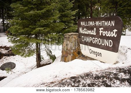 Fresh snow stands around the Oregon Campground sign in Wallowa-Whitman National Forest