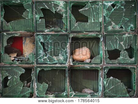The Wall Of Glass Blocks Is Broken By Stones