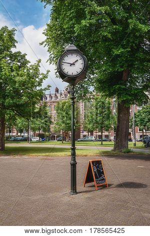 A characteristic clock somewhere on a square in Rotterdam in The Netherlands