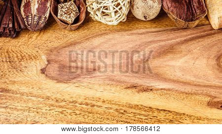 Aromatherapy potpourri mix of dried aromatic tropical seed and shell on wooden surface with empty space for text. Above.