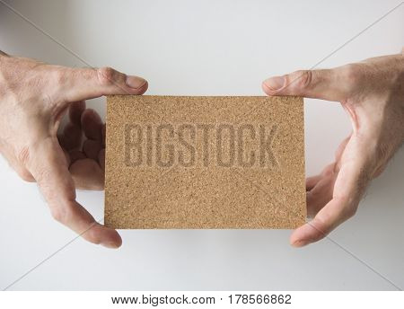 Hand Holding Paper Card Advertisement