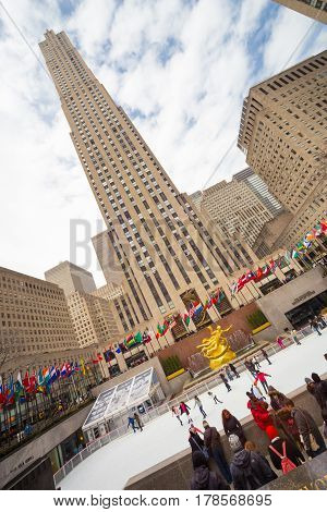 New York City, USA - March. 2015: New York City landmark, ice skaters and tourists visiting Rockefeller Center ice skate rink on on 24th of March, 2015.