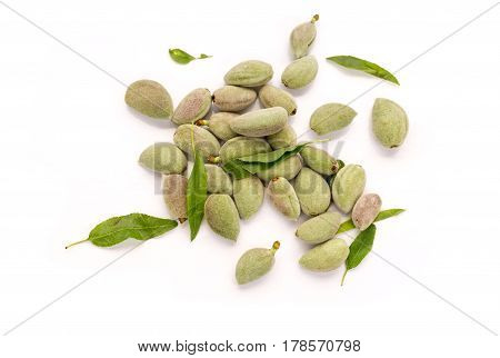 Fresh unripe almonds on white background top view