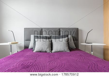 Big Bed With Grey Pillows