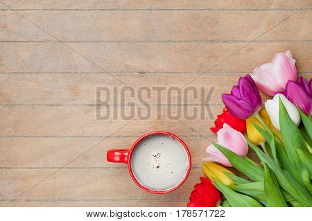 Photo Of Cup Of Coffee And Colorful Tulips On The Wonderful Brown Wooden Background