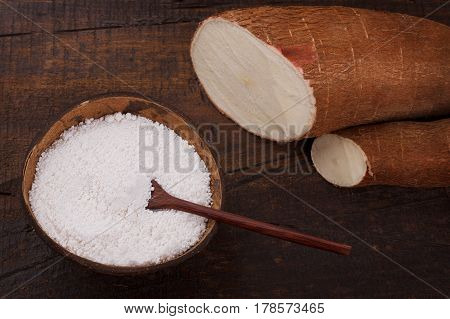 Manihot esculenta (cassava, yuca, manioc, mandioca, Brazilian arrowroot) -  woody shrub on wooden background. Selective focus