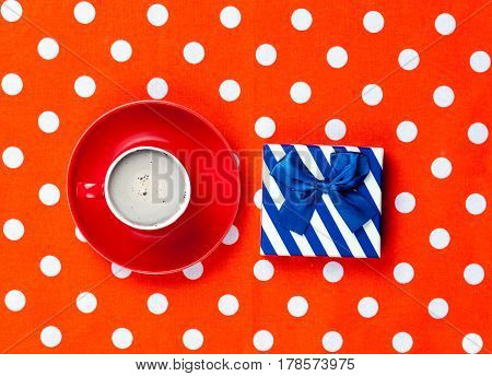 Photo Of Cup Of Coffee And Cute Gift On The Wonderful Red Dotted Background In Pop Art Style