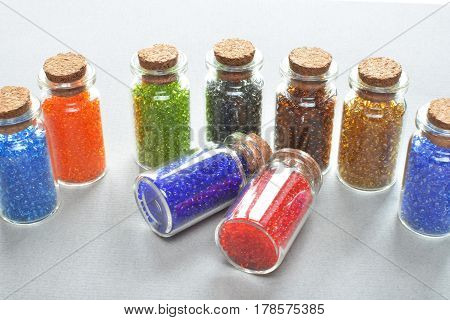 multi colored beads filled in the small glass bottles