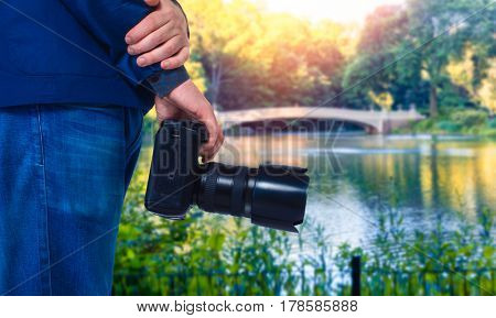 Male cameraman hands with digital camera