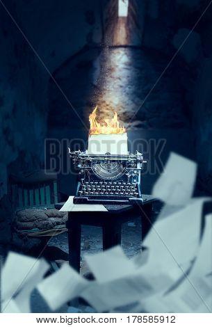 Old typewriter with burning sheet of paper