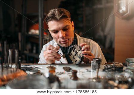 Watchmaker repair old mechanical clocks