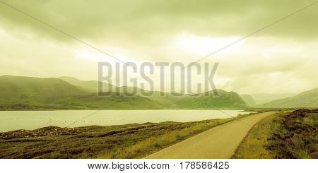 View on remote street in fjord landscape in Scotland