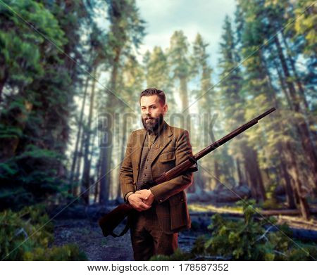 Hunter in vintage hunting clothing with old gun