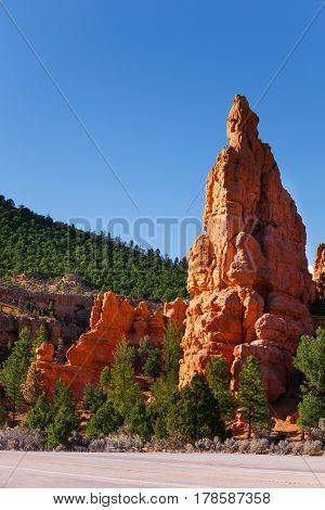 Road at the foot of sandstone mountain of Red Canyon National Park, Utah, USA