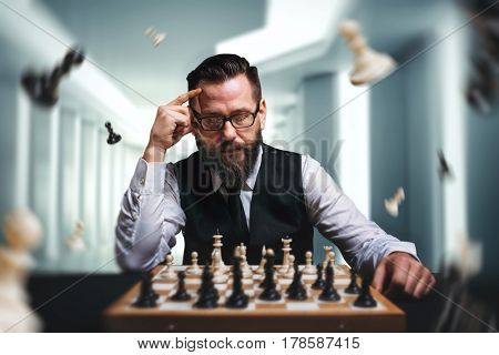 Chess player calculate movies and game strategy