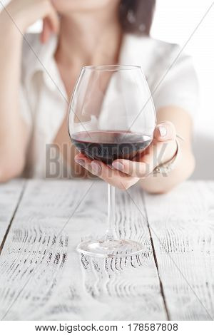 Woman Drinking Alcohol On White Background. Focus On Wine Glass