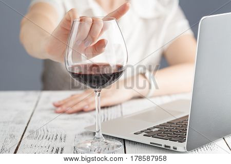 woman refuses to drink a glass of wine
