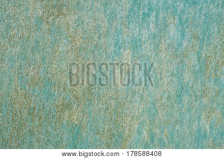 iron surface is covered with old green paint texture background