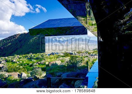 reflection of desert landscape in mirrored walls