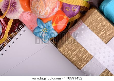 Arrangement Of Gift Boxes In Wrapping Paper With Checkered Ribbons And Decorated Easter Eggs. White