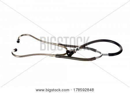 Vintage old doctor's stethoscope isolated on white