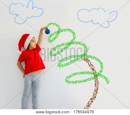 Little boy hanging a decorating ball with large copy space for your text or image