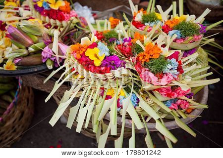 Baskets with flowers for offerings the island of Bali market