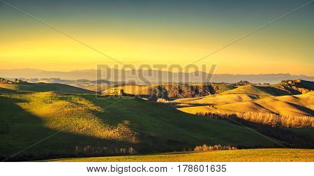 Volterra panorama rolling hills and green fields at sunset. Tuscany Italy Europe
