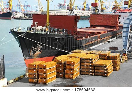 Bulk Cargo Ship And Metal Under Port Crane