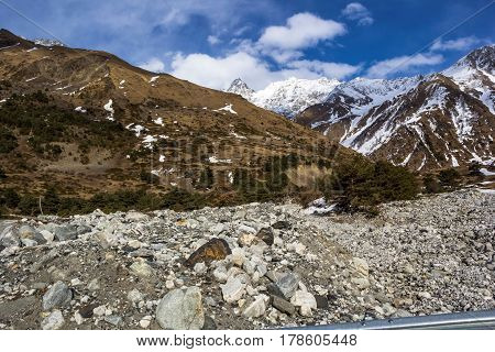 Descended a mudflow from stones in the mountain gorge, the North Caucasus, a mountain landscape