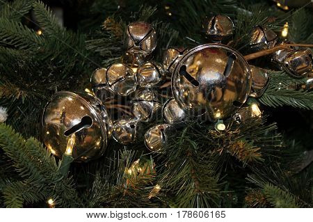 Shiny Gold Jingle Bells Hanging on a Christmas Tree