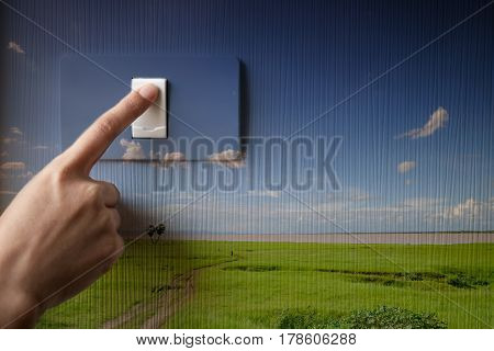 Close up of finger is turning on or off on light switch nature in background for saving energy concept. Copy space.