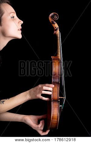 Woman Profile And Violin On Black Background