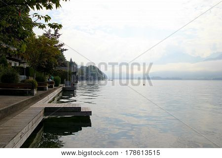 Travel To Sankt-wolfgang, Austria. The View On The Lake Wolfgangsee Near To Mountains In The Cloudy