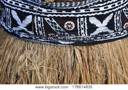 Background Of Traditional Pacific Island Straw Skirt And Tapa Cloth