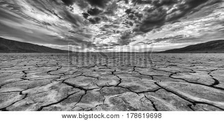 Clark dry lakebed during cloudy sunrise with mountains
