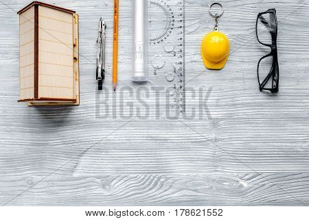 Architects workplace with constructor tools with glasses and miniature on light wooden table background top view mockup