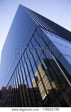 Dark, angular, reflective building in blue tones.