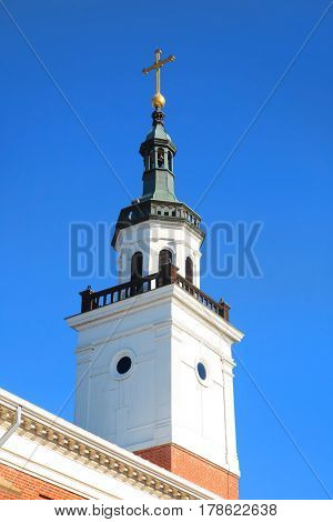 white church steeple and blue sky back ground
