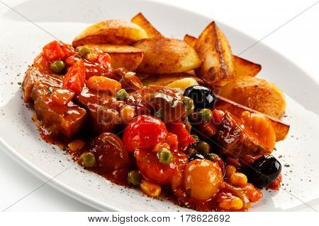 Roast meat and baked potatoes