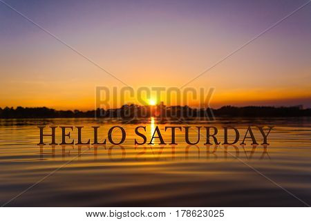 'HELLO SATURDAY ' with sunset water , twilight time