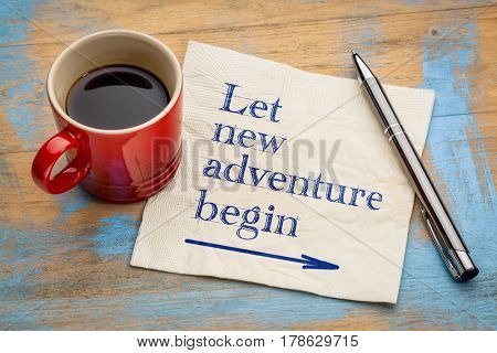 Let new adventure begin  - handwriting on a napkin with a cup of espresso coffee