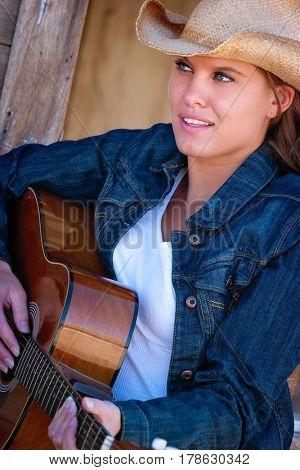 Beautiful smiling guitar playing woman