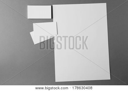 Blank brochure and business cards on grey background