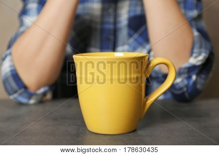 Blank cup and woman on background